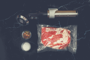 Immersion circulator with vacuum sealed meat and seasoning